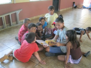 Dania reading to feeding program children