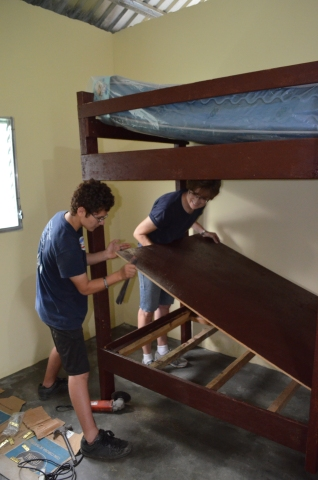 Ian and Sandy work together to assemble the boys' bunk-beds at the family's new home